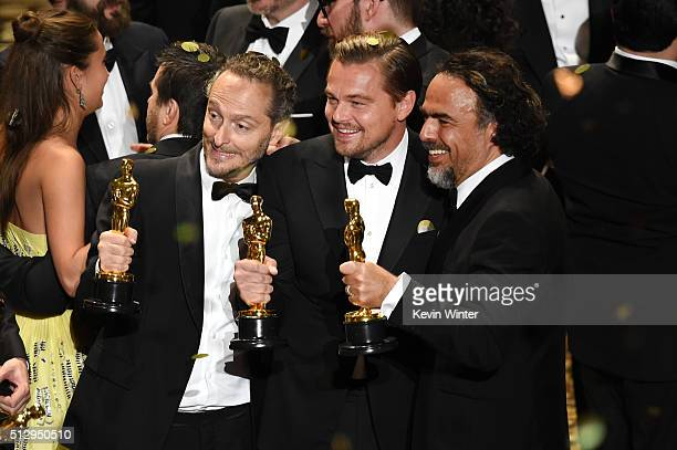 Cinematographer Emmanuel Lubezki actor Leonardo DiCaprio and director Alejandro Gonzalez Inarritu all winners for 'The Revenant' pose onstage during...