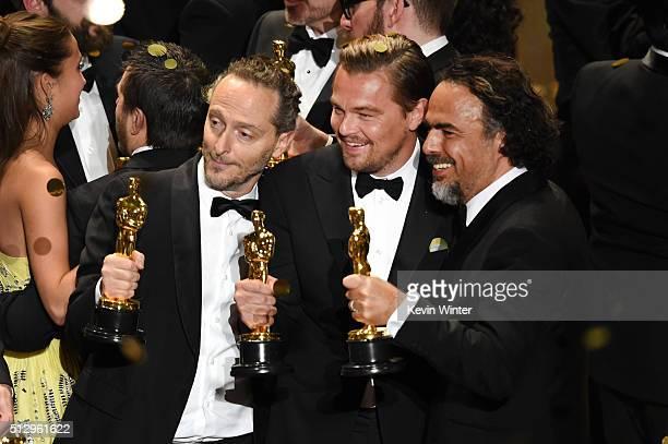 Cinematographer Emmanuel Lubezki actor Leonardo DiCaprio and director Alejandro Gonzalez Inarritu all winners for 'The Revenant' pose onstage during...