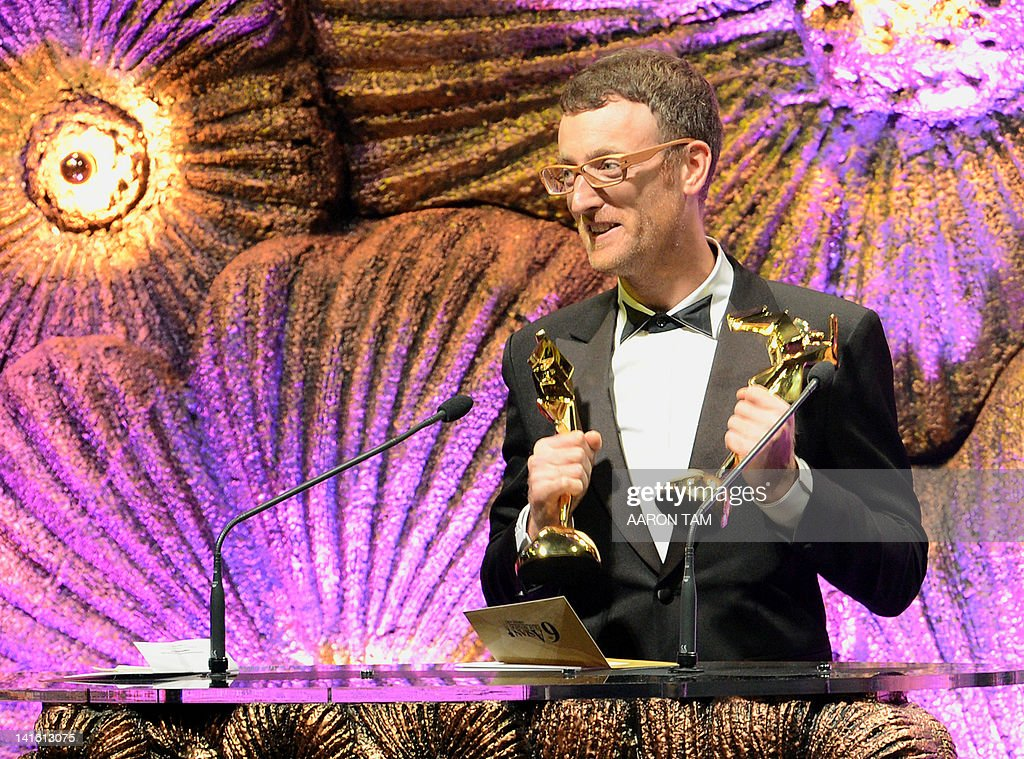 Cinematographer Jake Pollock speaks at the podium after receiving the award for Best Cinematographer with Lai Yiu-fai for the film 'Wu Xia' at the 6th Asian Film Awards in Hong Kong on March 19, 2012. AFP PHOTO / AARON TAM
