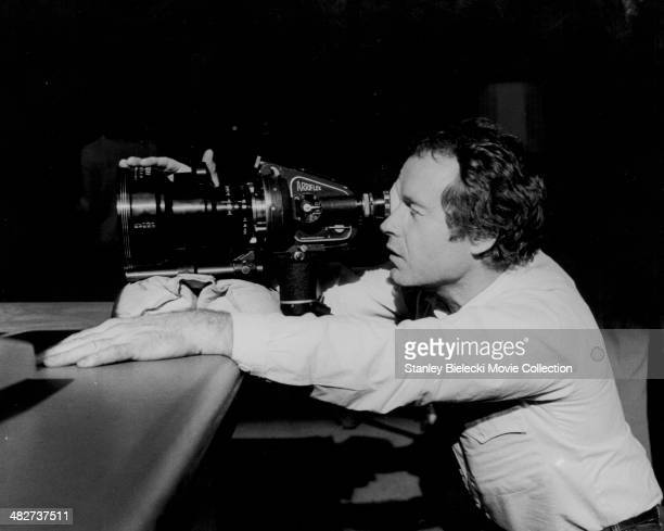 Cinematographer Jordan Cronenweth using an Arriflex camera on the set of movie 'Blade Runner' 1982