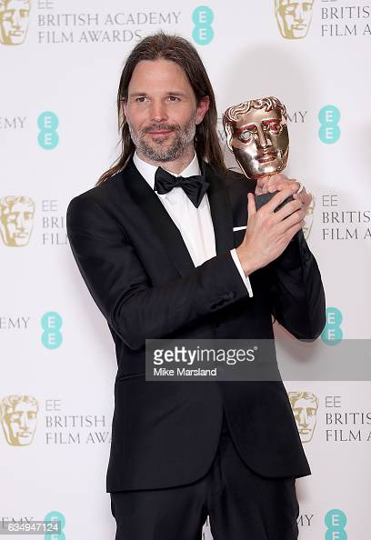 Cinematography Award winner Linus Sandgren poses in the winners room at the 70th EE British Academy Film Awards at Royal Albert Hall on February 12...