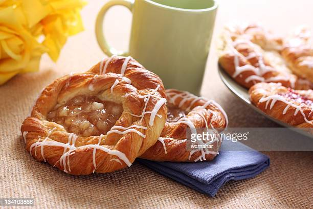 A cinnamon and cheese Danish on a table
