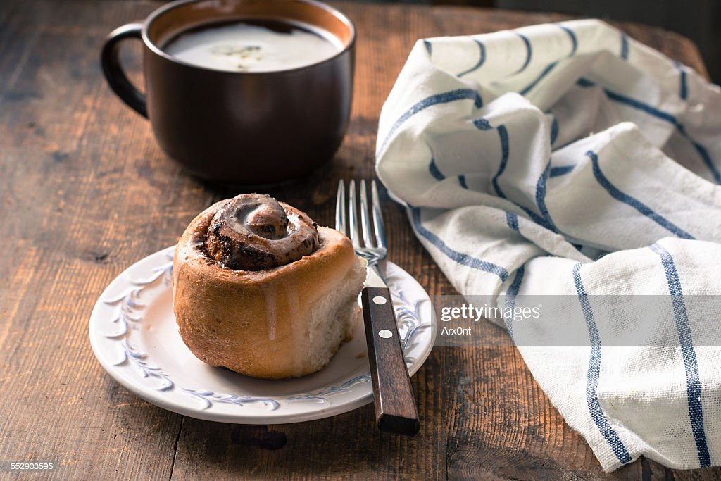 Cinnamon bun with coffee, breakfast image