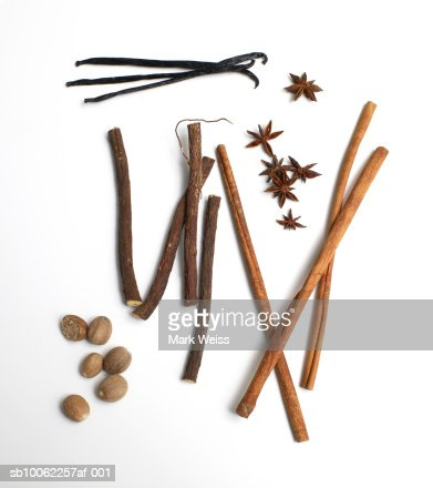 Cinnamon, vanilla, nutmeg, star anise and sugar cane against white background : Stock Photo