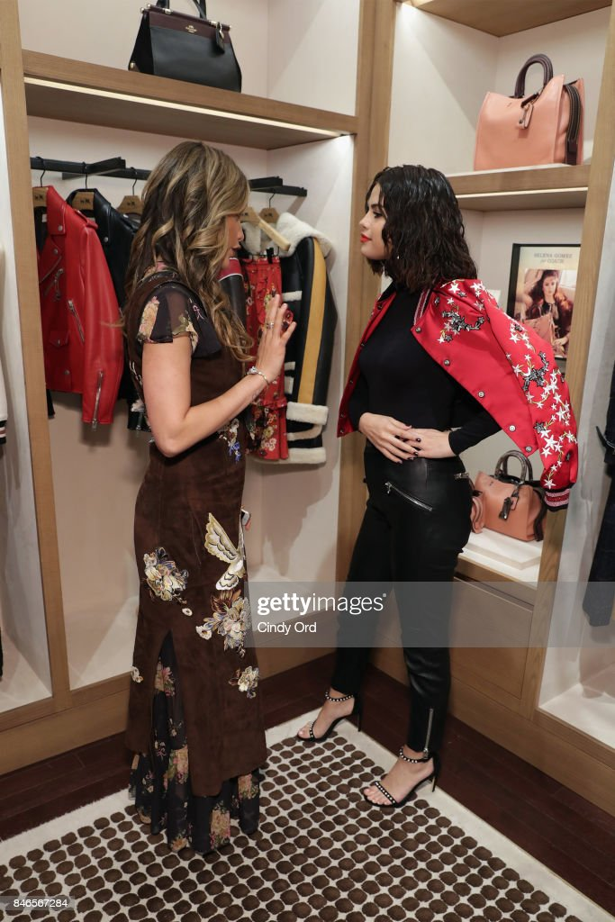 Cinta Laura Kiehl (L) and Selena Gomez pose during the Coach In-Store Event with Selena Gomez at Coach Boutique on September 13, 2017 in New York City.