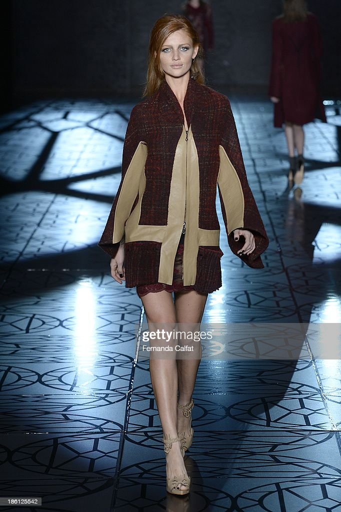 <a gi-track='captionPersonalityLinkClicked' href=/galleries/search?phrase=Cintia+Dicker&family=editorial&specificpeople=2325605 ng-click='$event.stopPropagation()'>Cintia Dicker</a> walks the runway during Animale show at Sao Paulo Fashion Week Winter 2014 on October 28, 2013 in Sao Paulo, Brazil.