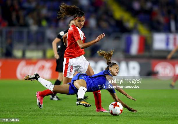 Cinzia Zehnder of Switzerland and Sakina Karchaoui of France compete for the ball during the Group C match between Switzerland and France during the...