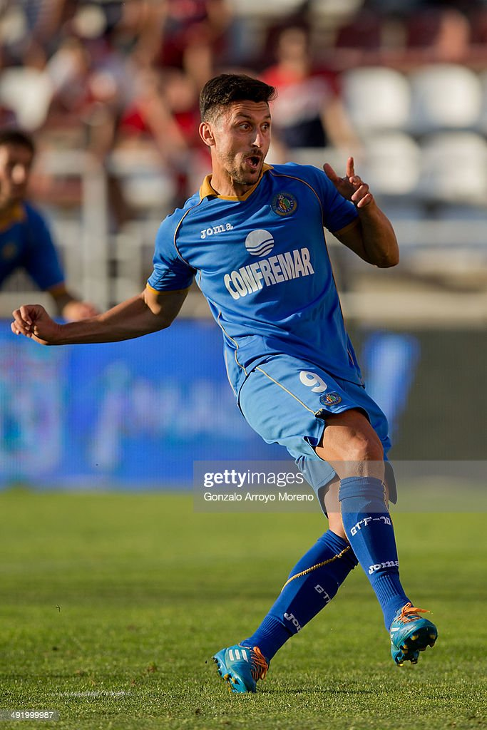 <a gi-track='captionPersonalityLinkClicked' href=/galleries/search?phrase=Ciprian+Marica&family=editorial&specificpeople=2178476 ng-click='$event.stopPropagation()'>Ciprian Marica</a> of Getafe CF gestures after scoring their second goal from a penalty shot during the La Liga match between Rayo Vallecano de Madrid and Getafe CF at Estadio de Vallecas on May 18, 2014 in Madrid, Spain.