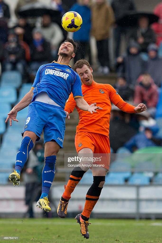 <a gi-track='captionPersonalityLinkClicked' href=/galleries/search?phrase=Ciprian+Marica&family=editorial&specificpeople=2178476 ng-click='$event.stopPropagation()'>Ciprian Marica</a> of Getafe CF wins the header after David Zurutuza of Real Sociedad during the La Liga match between Getafe SAD and Real Sociedad de Futbol at Coliseum Alfonso Perez on January 19, 2014 in Getafe, Spain.
