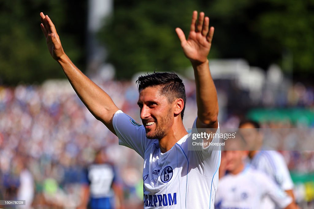 <a gi-track='captionPersonalityLinkClicked' href=/galleries/search?phrase=Ciprian+Marica&family=editorial&specificpeople=2178476 ng-click='$event.stopPropagation()'>Ciprian Marica</a> of Schalke celebrates the fifth goal during the first round DFB Cup match between 1. FC Saarbruecken and FC Schalke 04 at Ludwigspark Stadium on August 19, 2012 in Bremen, Germany.