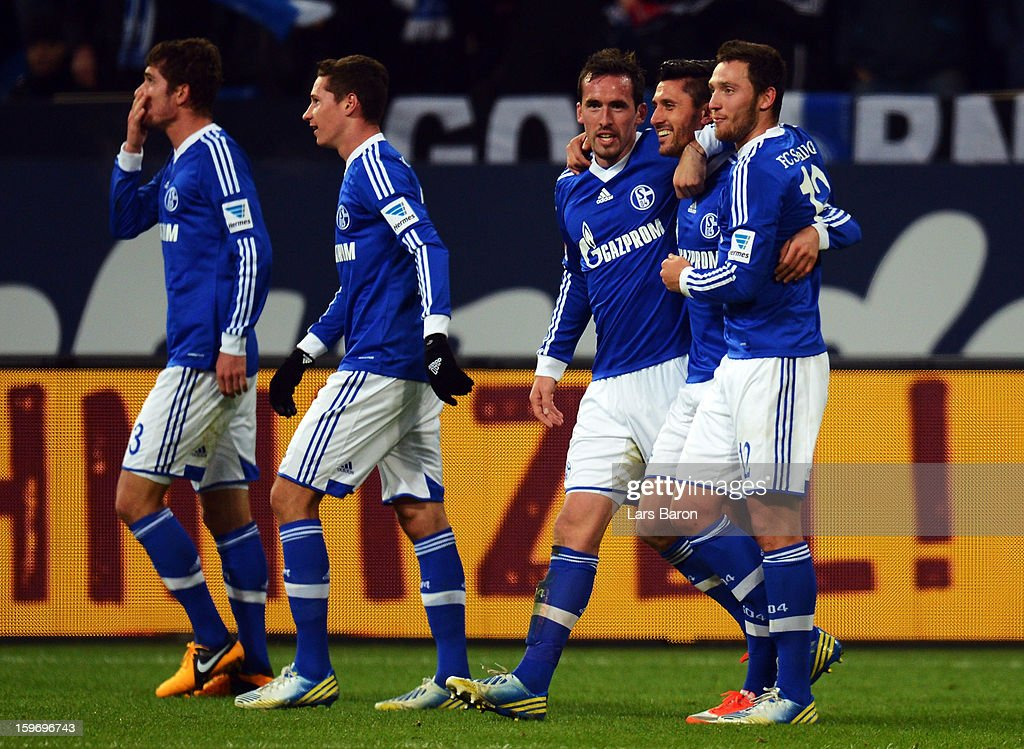 <a gi-track='captionPersonalityLinkClicked' href=/galleries/search?phrase=Ciprian+Marica&family=editorial&specificpeople=2178476 ng-click='$event.stopPropagation()'>Ciprian Marica</a> of Schalke celebrates with team mates after scoring his teams fourth goal during the Bundesliga match between FC Schalke 04 and Hannover 96 at Veltins-Arena on January 18, 2013 in Gelsenkirchen, Germany.