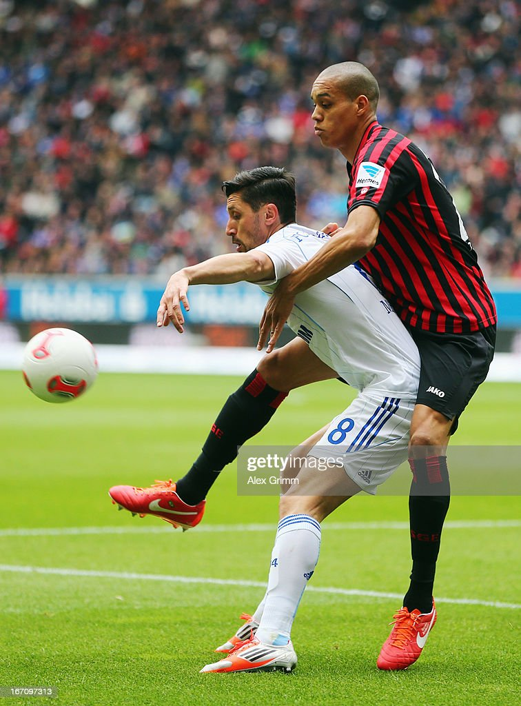 <a gi-track='captionPersonalityLinkClicked' href=/galleries/search?phrase=Ciprian+Marica&family=editorial&specificpeople=2178476 ng-click='$event.stopPropagation()'>Ciprian Marica</a> (L) of Schalke is challenged by Bamba Anderson of Frankfurt during the Bundesliga match between Eintracht Frankfurt and FC Schalke 04 at Commerzbank-Arena on April 20, 2013 in Frankfurt am Main, Germany.