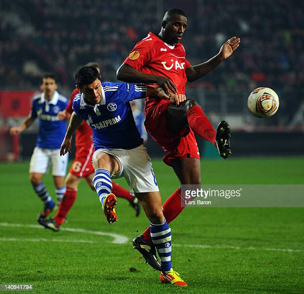 Ciprian MArica of schalke is challenged by Douglas of Twente during the UEFA Europa League Round of 16 first leg match between FC Twente and FC...