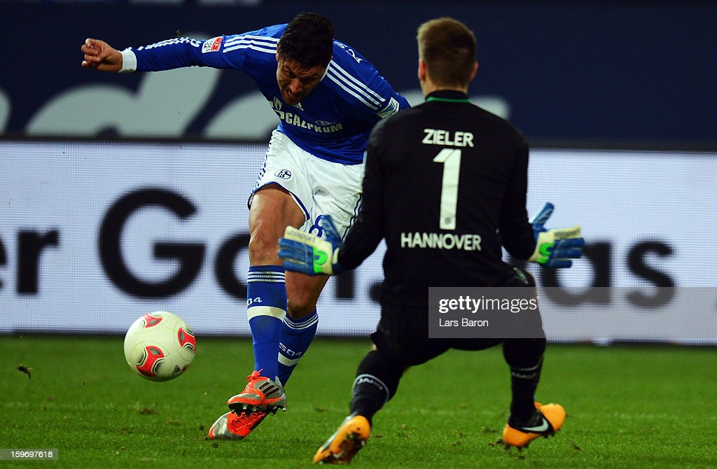<a gi-track='captionPersonalityLinkClicked' href=/galleries/search?phrase=Ciprian+Marica&family=editorial&specificpeople=2178476 ng-click='$event.stopPropagation()'>Ciprian Marica</a> of Schalke scores his teams fourth goal during the Bundesliga match between FC Schalke 04 and Hannover 96 at Veltins-Arena on January 18, 2013 in Gelsenkirchen, Germany.