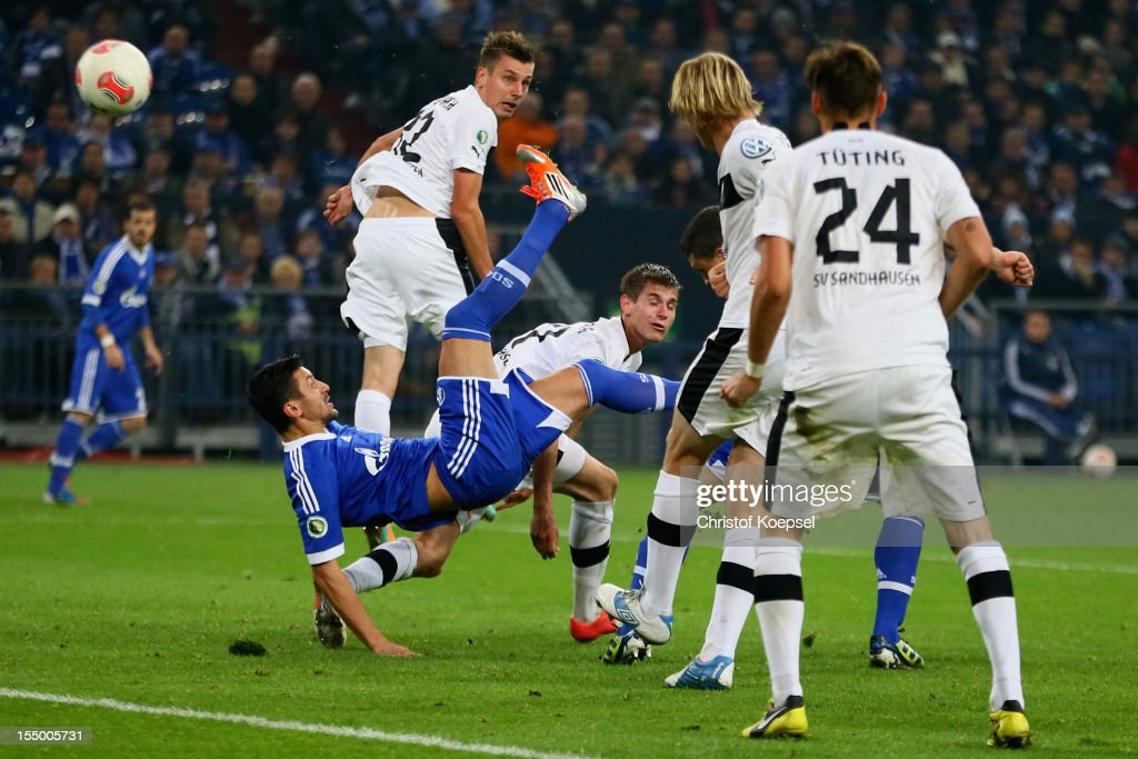 Ciprian Marica of Schalke scores the second goal during the DFB Cup second round match between FC Schalke 04 and SV Sandhausen at Veltins-Arena on October 30, 2012 in Gelsenkirchen, Germany.