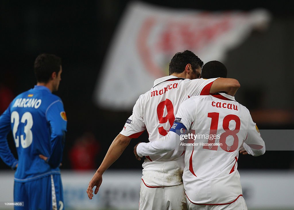 Ciprian Marica (C) of Stuttgart celebrates scoring his first team goal with his team mate Cacau whilst Ivan Marcano (L) of Getafe looks on during the UEFA Europa League group H match between VfB Stuttgart and Getafe CF at Mercedes-Benz Arena on October 21, 2010 in Stuttgart, Germany.