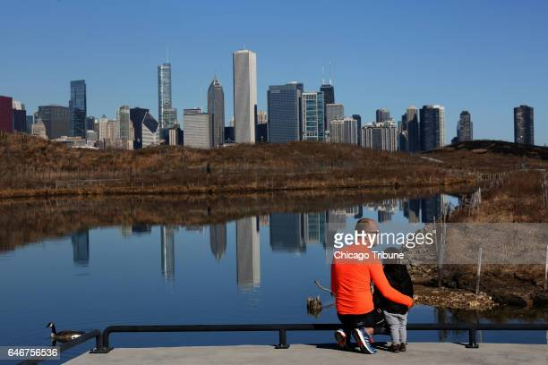 Ciprian Sava and his son Sebastian of Chicago Ill look out across Northerly Island on an unseasonably warm day on Feb 19 2017