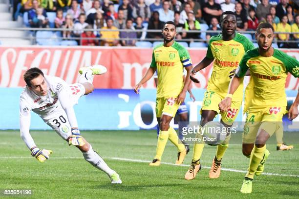 Ciprian Tatarusanu goalkeeper of Nantes stops the ball under the eyes of Levy Djidji Anthony Walongwa and David Alcibiade of Nantes during the Ligue...