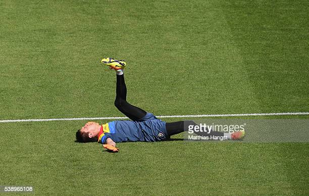 Ciprian Tatarusanu of Romania stretches during training session ahead of the UEFA EURO 2016 Group A match between France and Romania at Stade de...