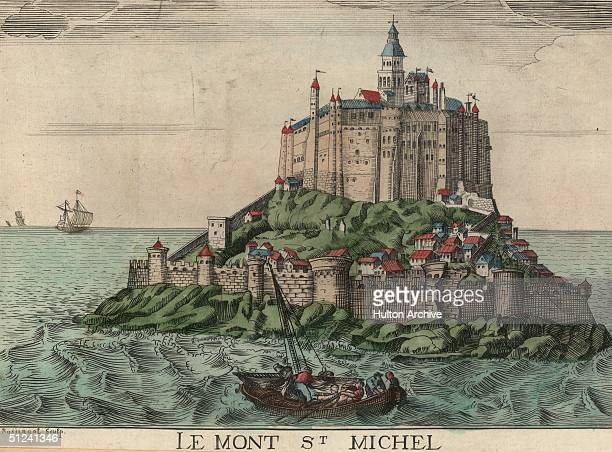 The medieval stronghold of Mont Saint Michel in Normandy France dominated by the abbey church The islet was once cut off from the mainland at high...