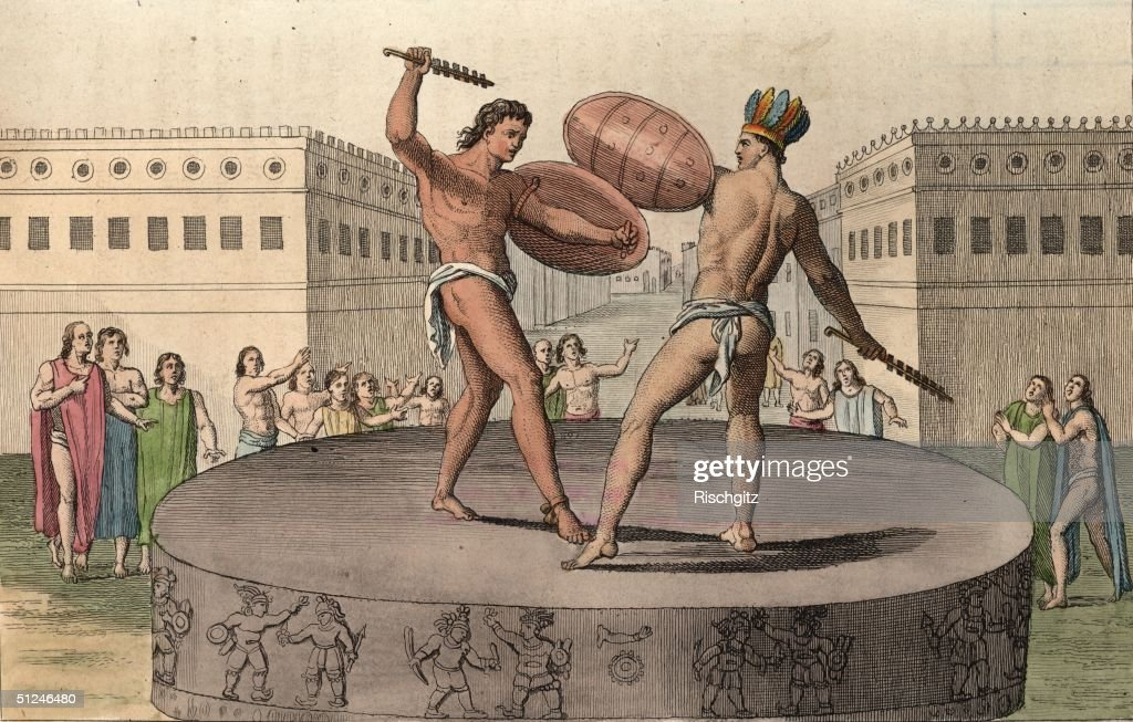 Circa 1500 A pair of Aztec gladiators battle each other on a raised stone plinth watched intensely by a group of onlookers One of the contestants...