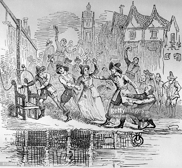 Circa 1600 An old woman is dragged to the ducking stool at Ipswich Suffolk The ducking stool was a chair in which people were restrained and ducked...