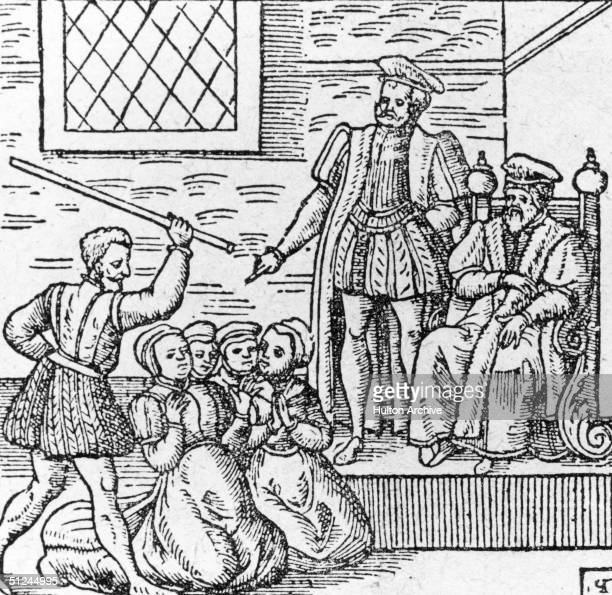 Circa 1610 A group of supposed witches being beaten in front of King James I