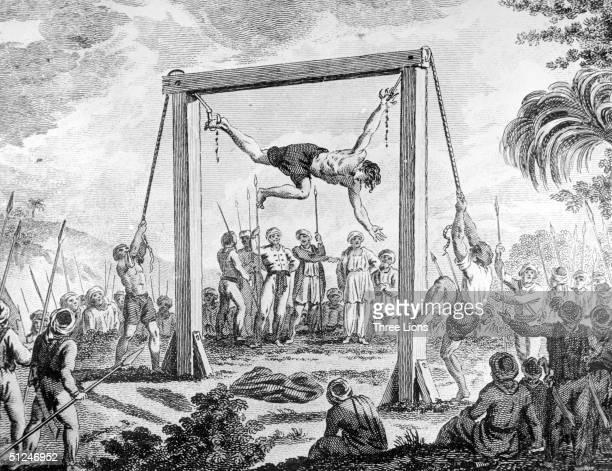 Circa 1700 A Christian attempting to escape from slavery is executed by Algerian Muslims grappling hooks are driven through one hand and foot and he...