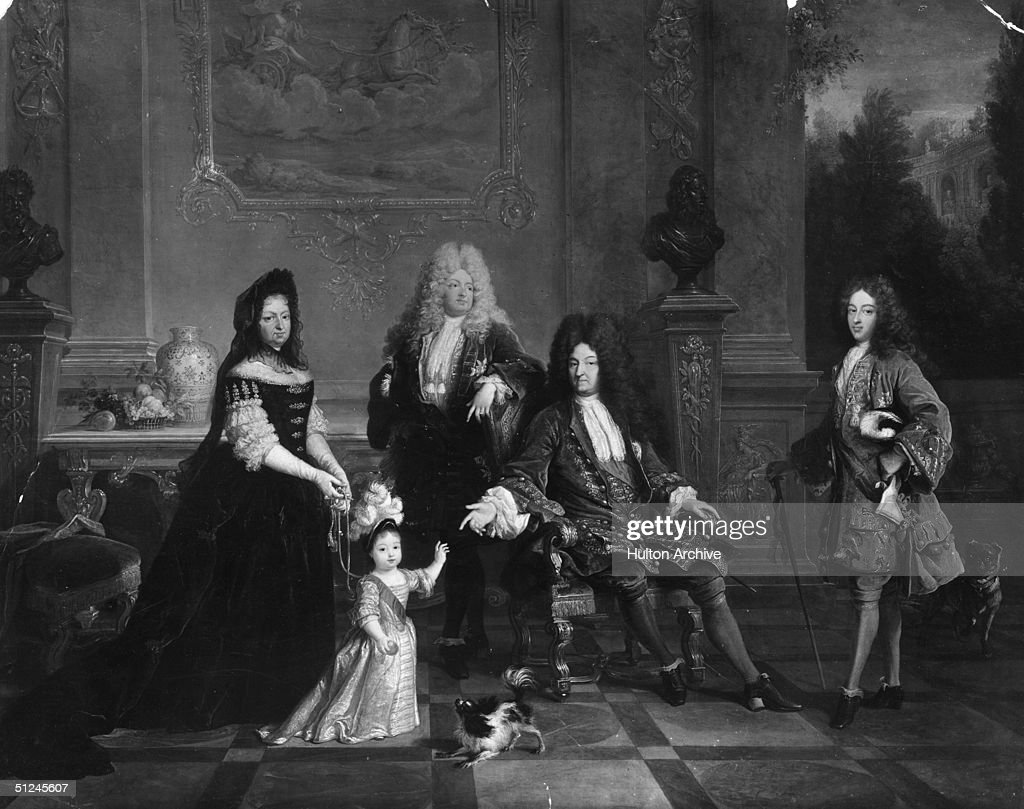 Circa 1710 King Louis XIV of France with his family From left to right the Duchess of Ventadour the Duke of Anjou later Louis XV the Grand Dauphin...