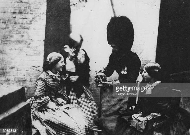 A photograph using the recently invented calotype process of a soldier wearing a busby showing a human skull to three women