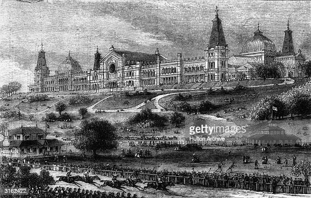 A horse race at Alexandra Park in north London with Alexandra Palace in the background