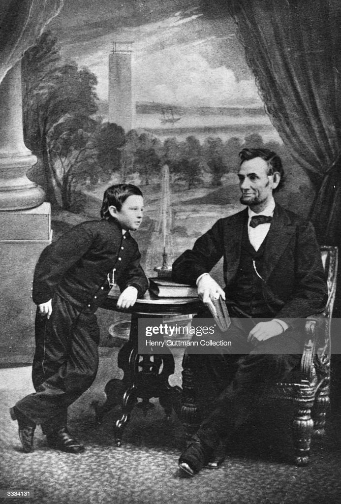 The 16th President of the United States, Abraham Lincoln (1809 - 1865) with his son Thomas.