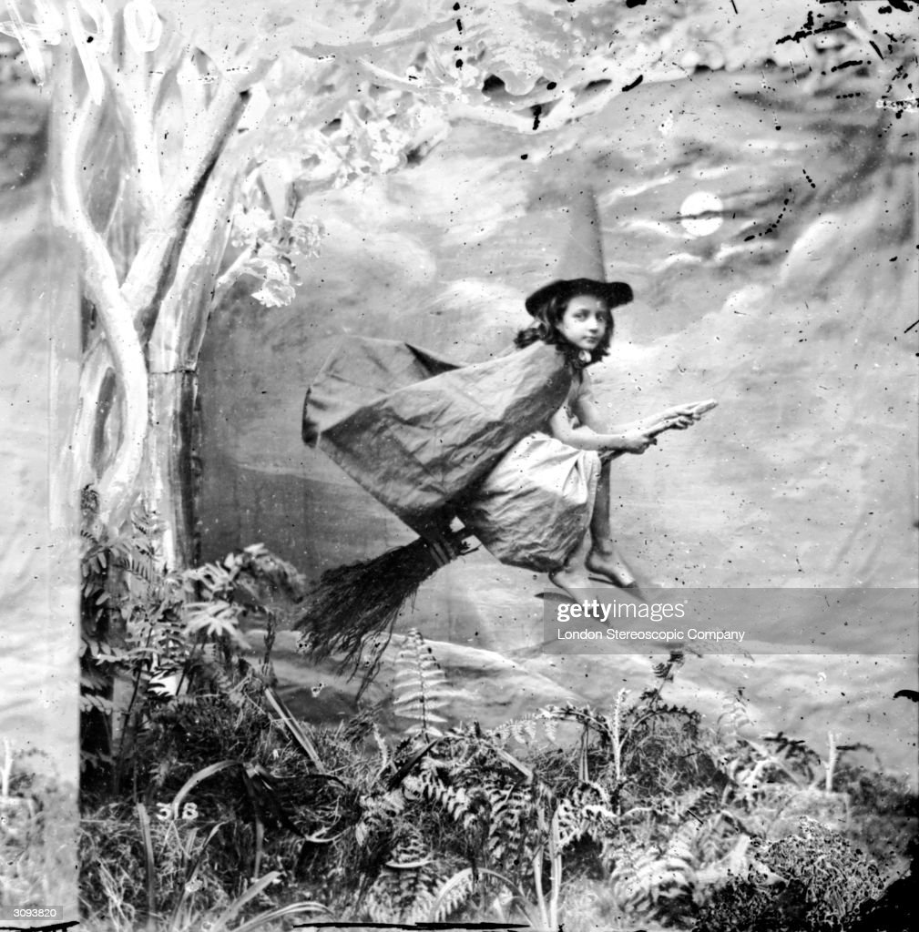 A young girl dressed as a witch suspended midair on a broomstick London Stereoscopic Company Comic Series 318