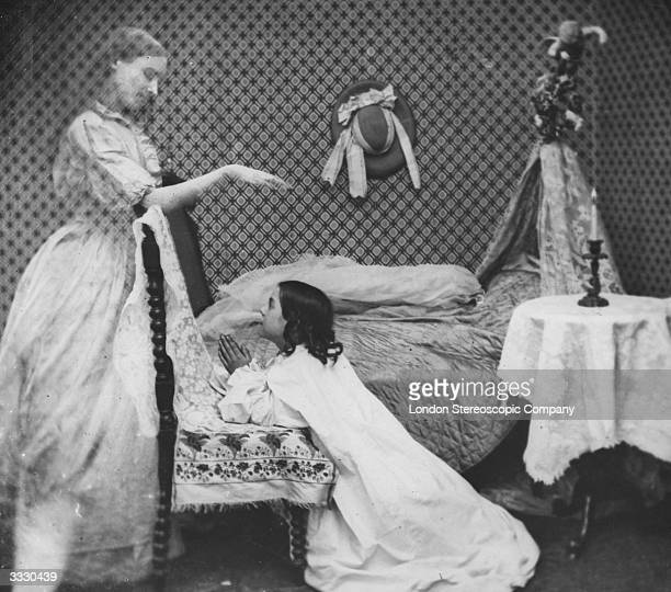 The ghost of a woman appears to a girl at prayer by her bedside London Stereoscopic Company Comic Series 183