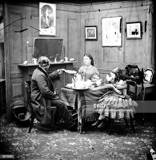 Two children enjoying a afternoon tea at home with their father London Stereoscopic Company Comic Series 375