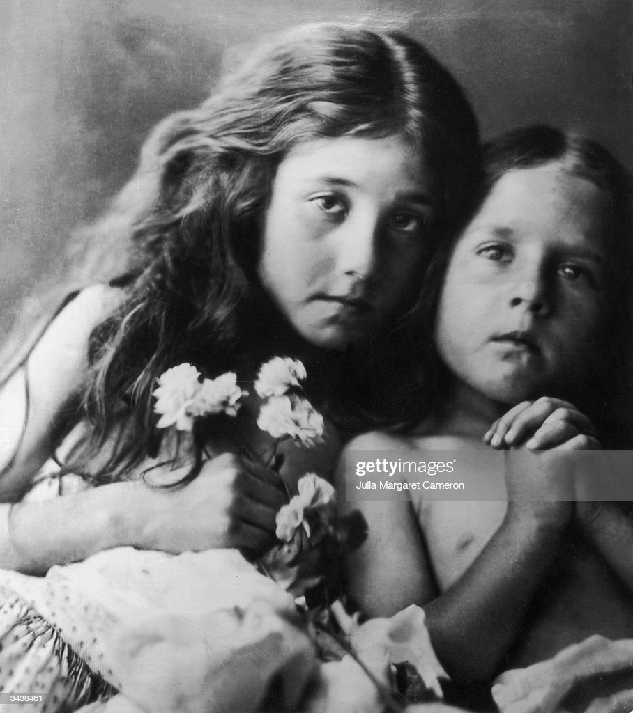 Two young girls posing with flowers in a Julia Margaret Cameron portrait entitled 'The Sad White Roses'