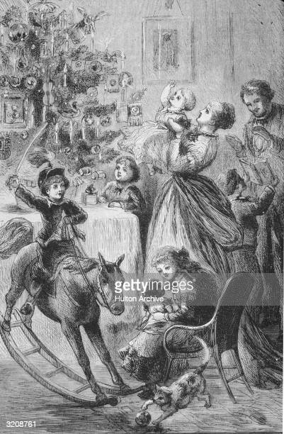 Illustration of a family gathered in their living room on Christmas morning nineteenth century A young boy rides a rocking horse as his sister sits...