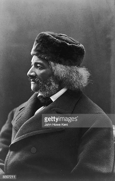 Profile portrait of American social reformer orator writer statesman and former slave Frederick Douglass wearing a hat and a winter coat