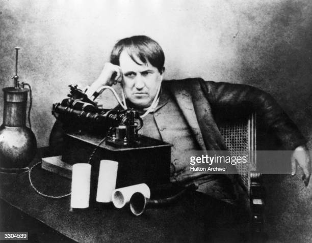 Thomas Alva Edison American scientist inventor and industrialist after spending 5 continuous days and nights perfecting the phonograph listening...