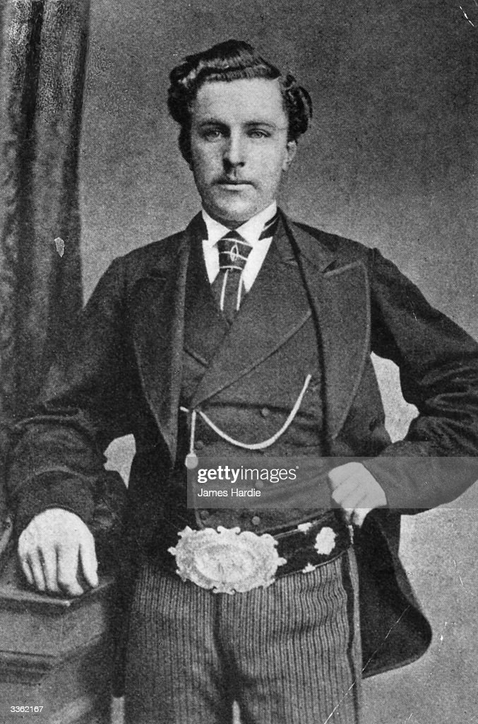 Scottish golfer 'Young' Tom Morris (1851 - 1875) wearing the British Open belt which he won four times. 'Young' Tom and his father 'Old' Tom became the only father and son to hold successive Open titles when 'Old' Tom became the oldest player to win a title, aged 46 years and 99 days, in 1867 and 'Young' Tom won in 1868 to become the youngest Open Champion. 'Young' Tom began his playing career at an early age winning an exhibition match at Perth aged only 13, and winning his first professional tournament three years later.