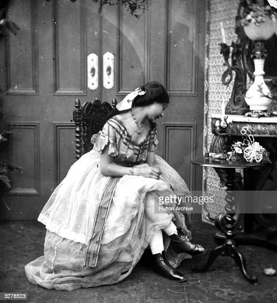A young lady in the act of dressing during the Victorian era