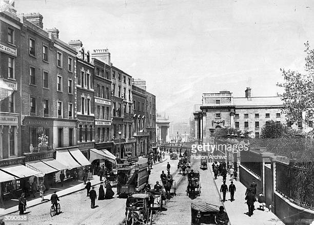 The bottom of Grafton Street Dublin with the facade of Trinity College at the foot