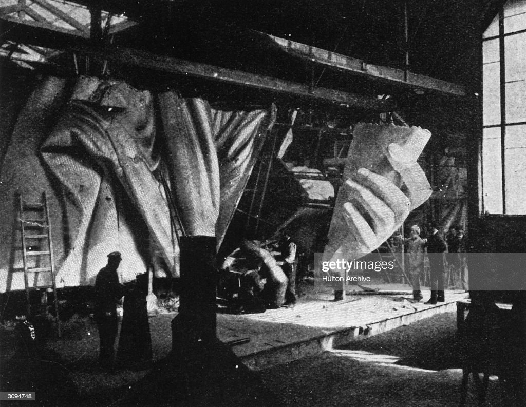 The left hand of the Statue of Liberty under construction. Sixty men have worked for almost ten years on the various parts of the statue, not including its designer Frederic Bartholdi and his assistants. Original Publication: From The Strand Magazine.