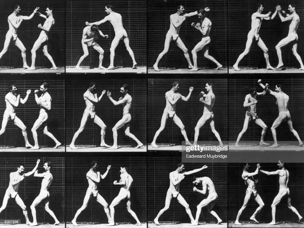 Twelve full-length images of two men clad in jock straps sparring outdoors in front of a grid backdrop. Photograph, entitled 'Open Hand Boxing,' by Eadweard Muybridge. Original Publication: From 'Animal Locomotion' - pub. 1887.