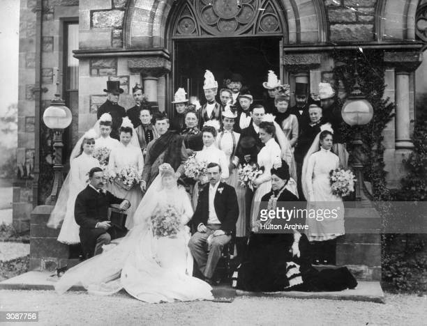 A wedding party pose on the steps of the church