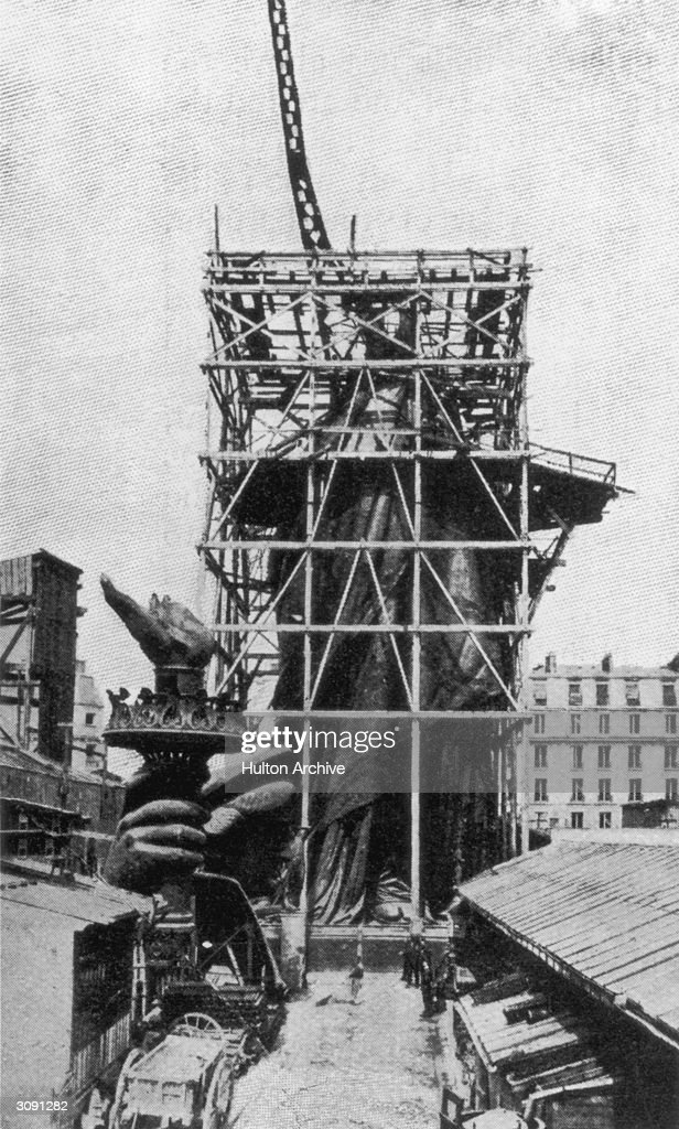 The framework for the right arm of the Statue Of Liberty during construction in Paris. Designed by the French sculptor Frederick Bartholdi, the statue was presented to the United States by France in 1876.