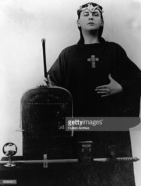 English author magician and occultist Aleister Crowley with a selection of occult instruments