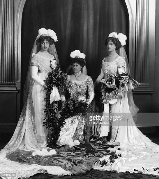 Mrs Latham poses with two bridesmaids on her wedding day