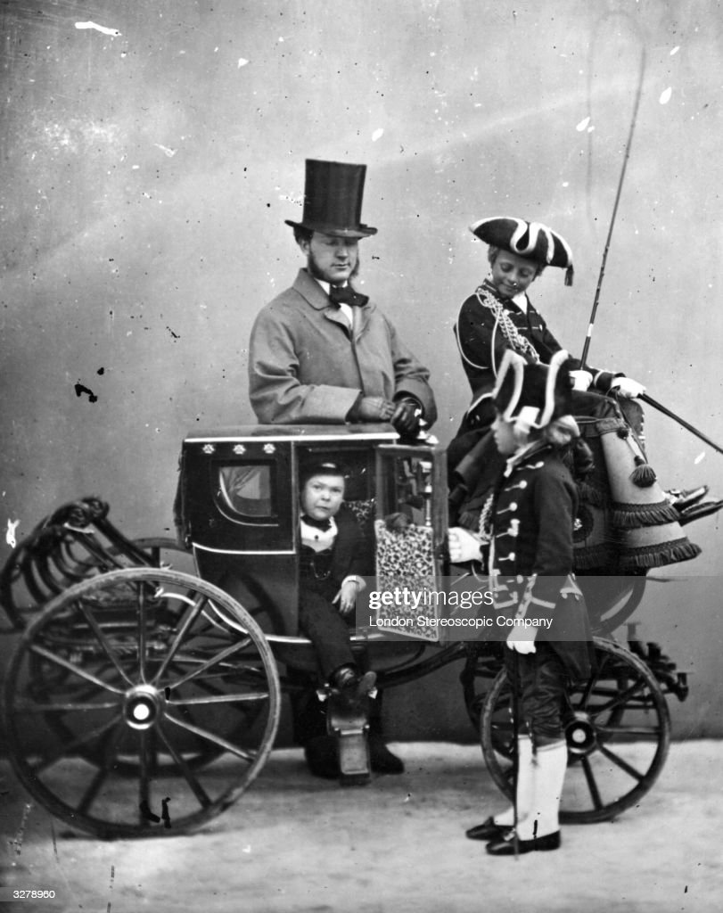 Portrait of the dwarf, Tom Thumb, stepping into his carriage. Charles Sherwood Stratton (1838 - 1883) was nicknamed General Tom Thumb by P T Barnum, the circus owner.