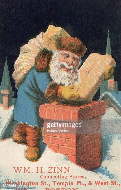 Santa Claus drops Christmas presents down a brick chimney while standing on a rooftop in a trade card illustration for the William H Zinn Import...